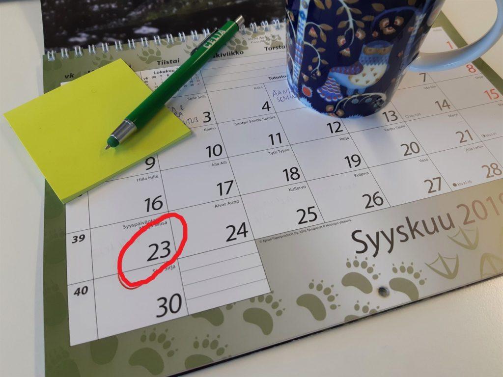 Kalenterin sivu, josta ympyröity punaisella päiväys 23.9.